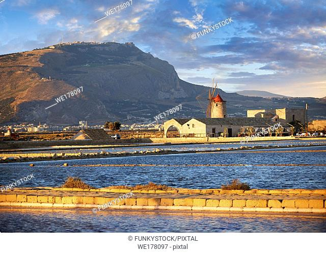 Pictures & images of the salt pans of the Nubia Salt works Museum and Nubia wind mill with Erice on the hills behind, World Wildlife reserve of Saline di...