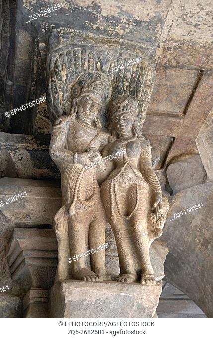 Badami - Karnataka, Rock - cut cave, portico, Mithuna (amorous couple) on pillar capital