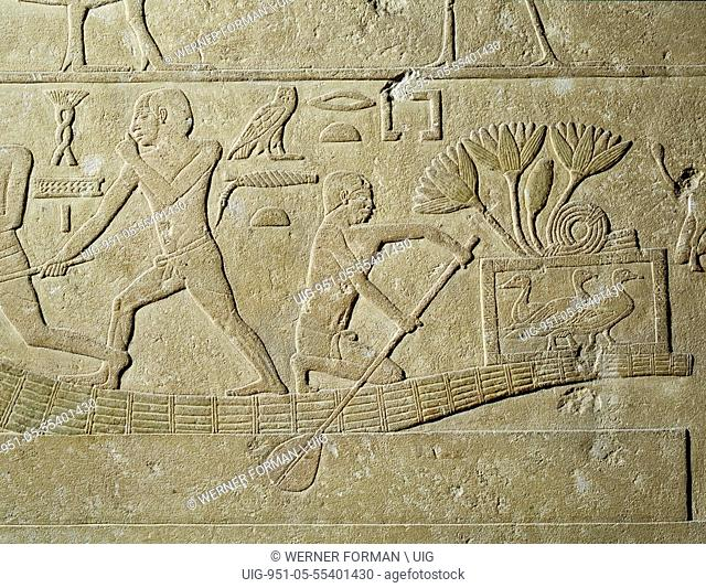 A relief depicting hunters in papyrus reed boats with captured birds in baskets