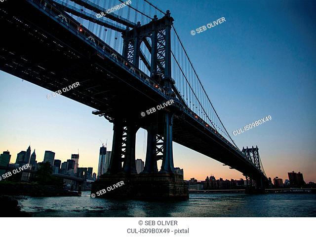 Low angle view of Manhattan bridge at sunset, New York, USA