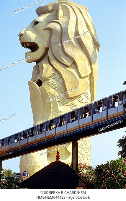 Singapore, Sentosa island, the famous and giant Merlion statue with lion head and fish body which is the emblem of Singapore in front of which passes the...