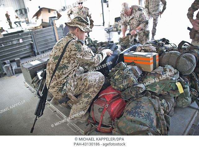 German soldiers pack up their gear at the port of Kunduz, Afghanistan, 04 October 2013. After the official transfer of the field camp to the Afghanistan Army...