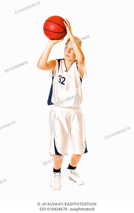 Young basketball player wearing white team uniform, studio shot, white background