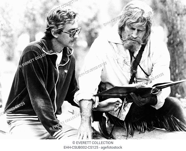 Screenwriter Fraser Clark Heston (left) discusses a scene with his father, Charlton Heston. They were on the set of Columbia Pictures THE MOUNTAIN MEN