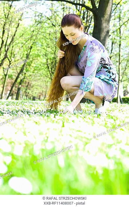 Girl picking up flowers