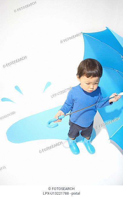 Boy with an umbrella