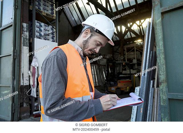 Young male engineer working at construction site, Freiburg Im Breisgau, Baden-Württemberg, Germany