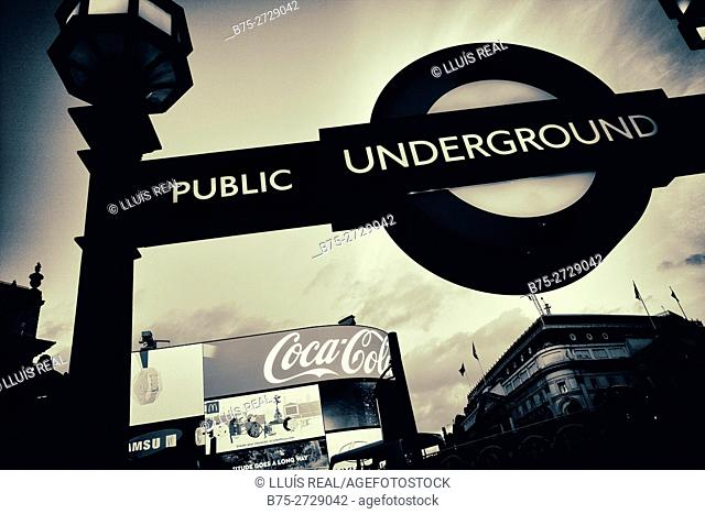 Underground sign, bus and video displays in Piccadilly Circus, London, England