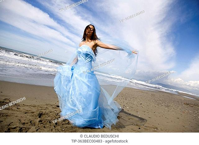 Bride in wedding day on the beach
