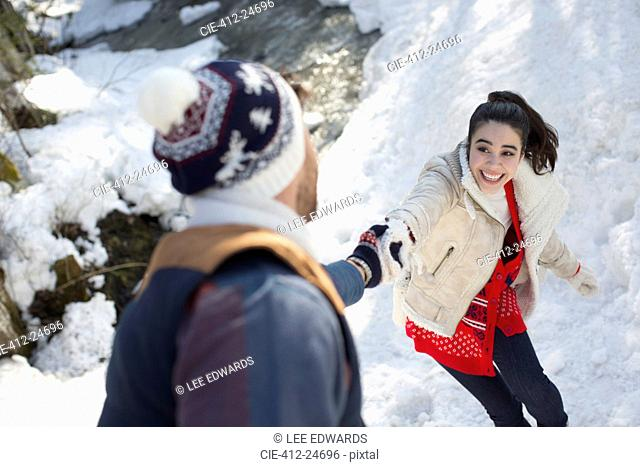 Couple holding hands in snow