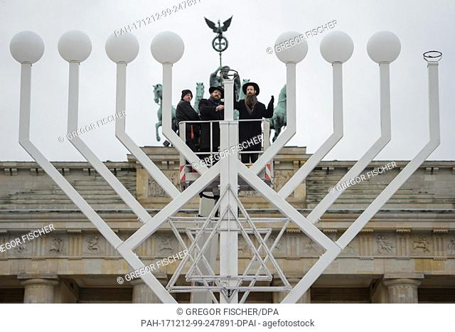 The two Rabbis of the Jewish Educational Centre Chabad, Jehuda Teichtal (L-R) and Shmuel Segal consecrate the largest Hanukkah Candelabra of Europe at the...