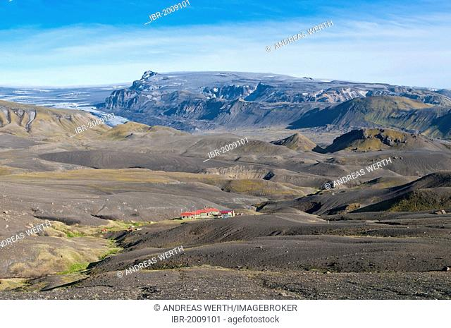 Huts for hikers in Botnar, Emstrur, Laugavegur hiking trail, Myrdalsjokull Glacier at the rear, ash from the 2011 eruption of Grimsvoetn volcano on the snow