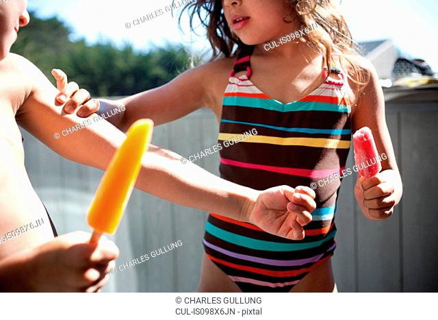 Children eating ice lollies