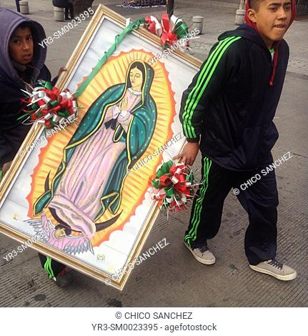 Young pilgrims carry an image of the Virgin of Guadalupe during the annual pilgrimage to the Our Lady of Guadalupe basilica in Mexico City, Mexico