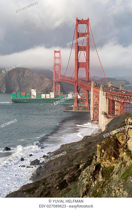 Cargo Ship crossing the Golden Gate Bridge on a Rainy Day, San Francisco, California, USA