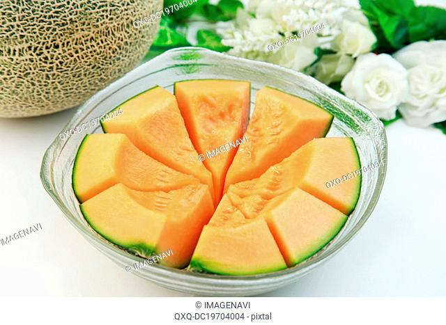 Sliced melon in glass bowl