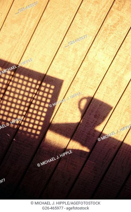 Shadow of coffee mug