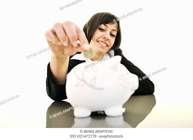 business woman putting coins money in piggy bank