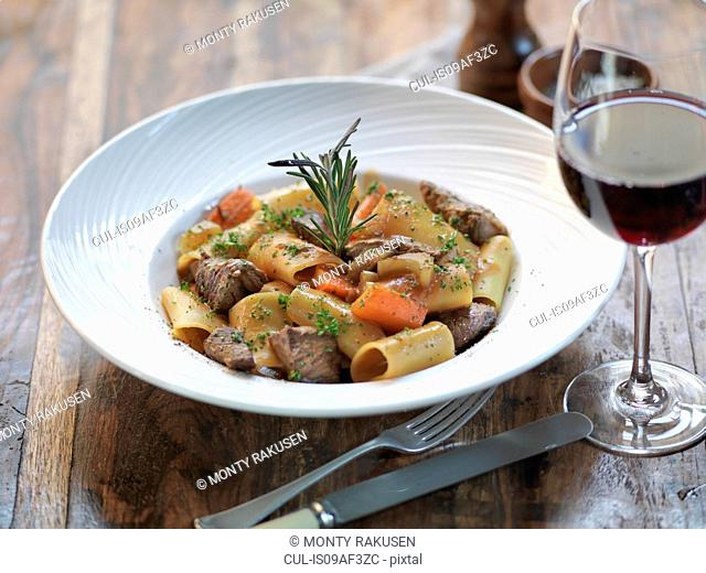 Paccheri pasta with slow cooked ox cheek, fresh rosemary, garlic, bay leaves, tomato and red wine