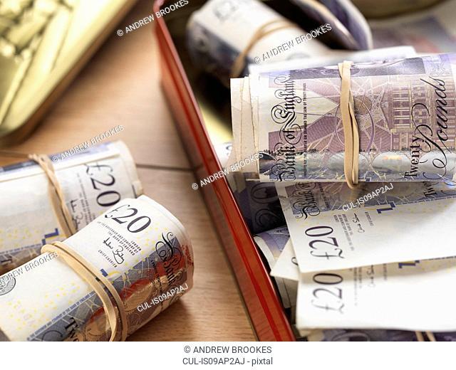 Cash savings in biscuit tin