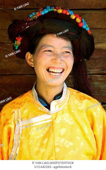 a smiling Mosu minority woman