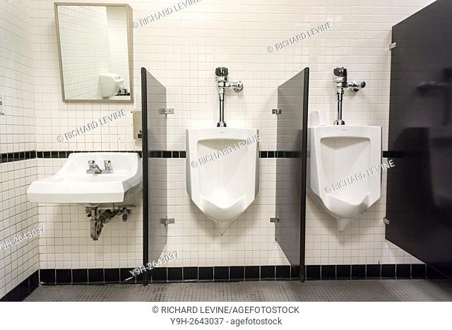 Urinals await customers in a restroom in New York
