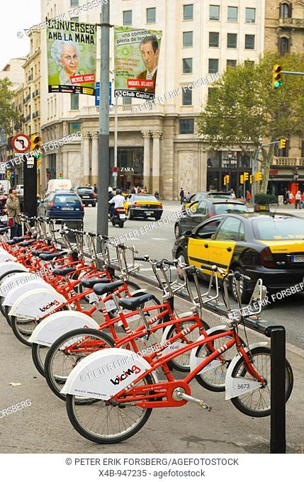 Bicing free of charge bicycles and traffic in Gracia district of Barcelona Spain Europe