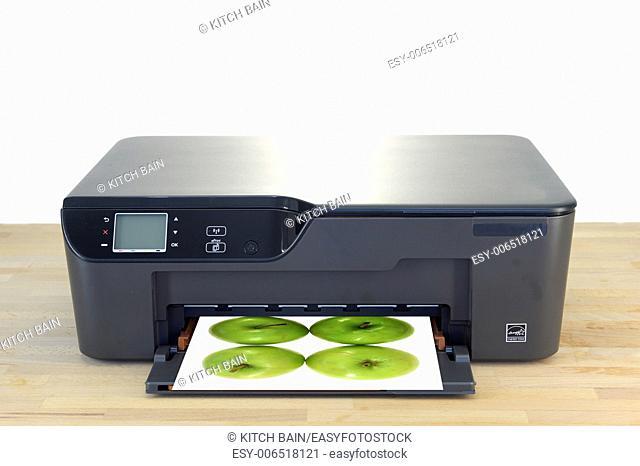 A close up shot of a color printer