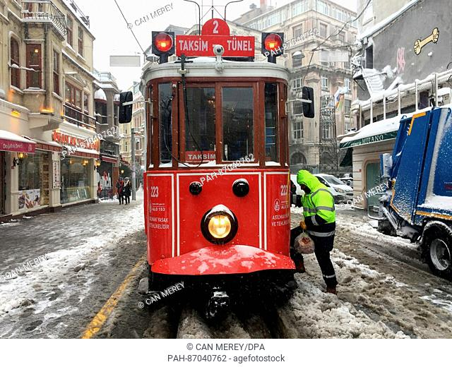 The historic tram in the area of the Istiklal Caddesi shopping street drives through the slush in Istanbul, Turkey, 7January 2017