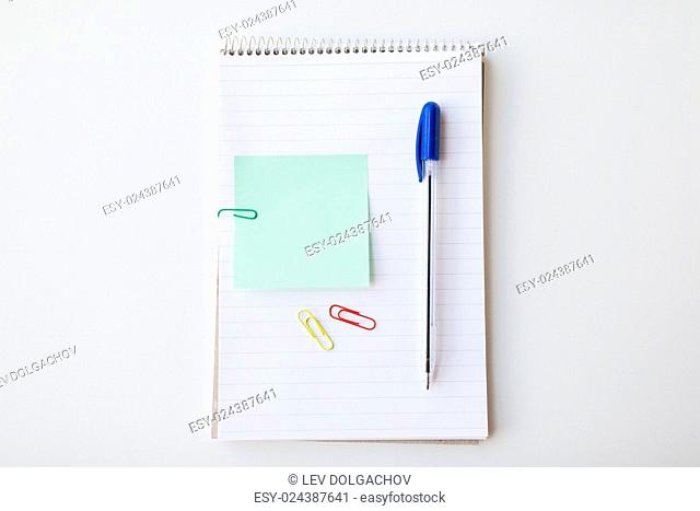 business, information, memo, management and education concept - close up of notebook with pen and bank paper on office table