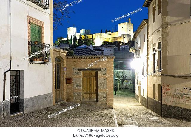 View of the Alhambra seen from some narrow streets in Albaycin, Province Granada, Andalucia, Spain