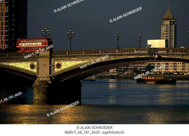Bus moving on an arch bridge, Battersea Bridge, London, England