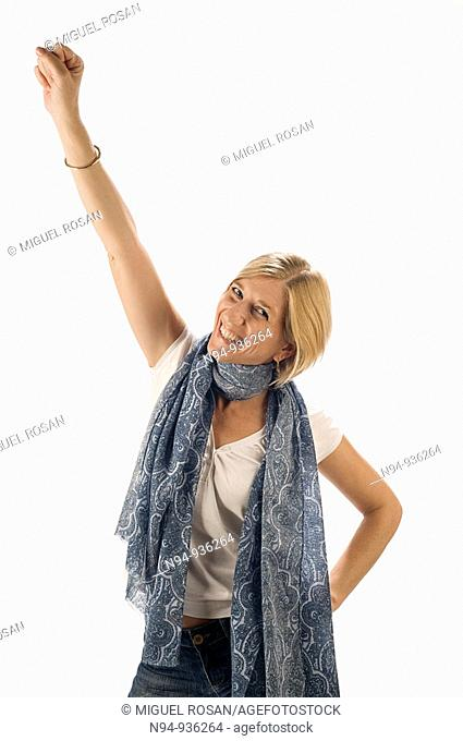 Young blond girl with arm raised in a gesture of fun