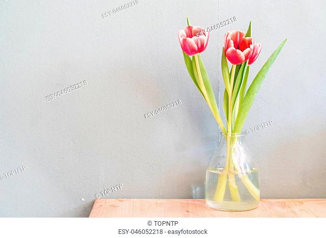 tulip flowers in vase - home decoration