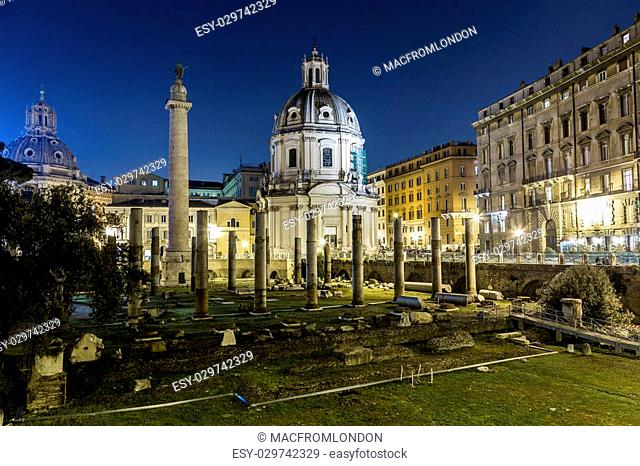 Part of the Trajan's Forum (Foro Di Traiano) at night showing some of the ruins, Trajan's Column, Santissimo Nome di Maria al Foro Traiano Church and other...