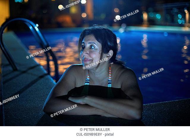 Woman in swimming pool looking away, Bangkok, Krung Thep, Thailand, Asia