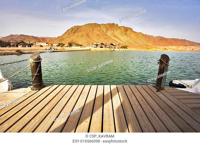Boat mooring in small lake in park Timna