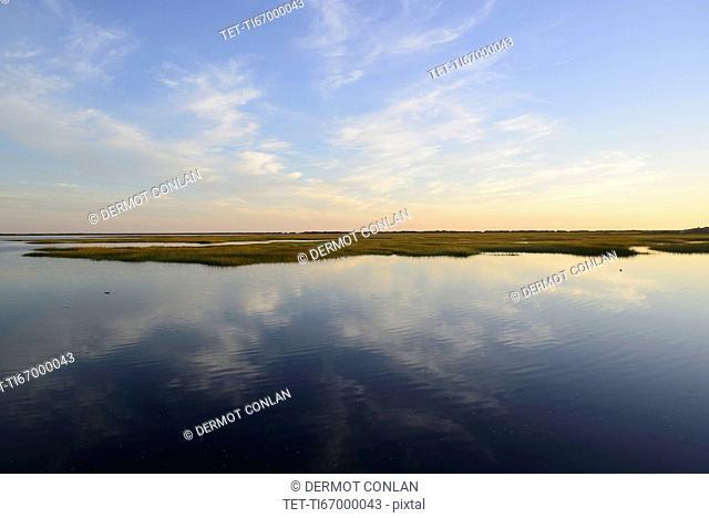 Sky reflecting in still bay