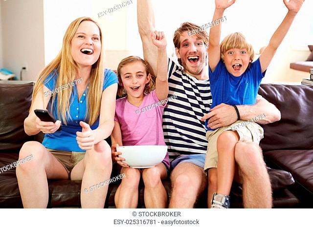 Family Watching Soccer on TV Celebrating Goal