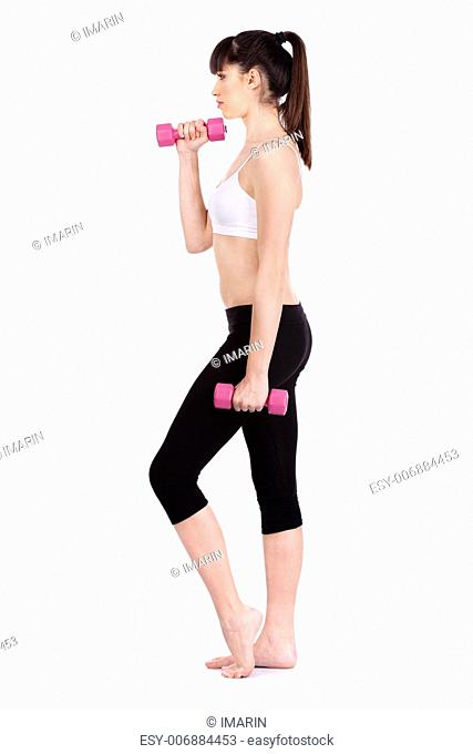 Young woman doing fitness exercises with two weights, isolated on white