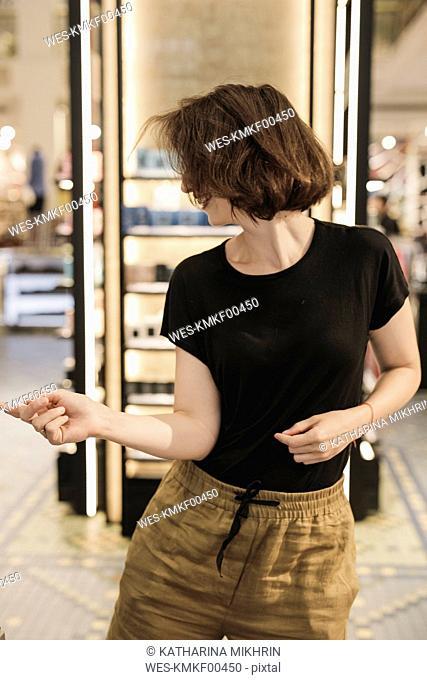 Happy woman dancing in a shop