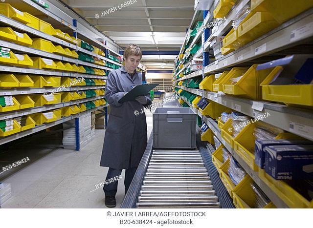 Preparing order, office supplies at store house. Guipuzcoa, Euskadi, Spain