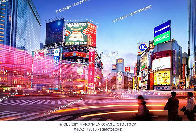 Colorful city scenery with traffic light trails at intersection in Shibuya, Tokyo, Japan during sunset. 2014
