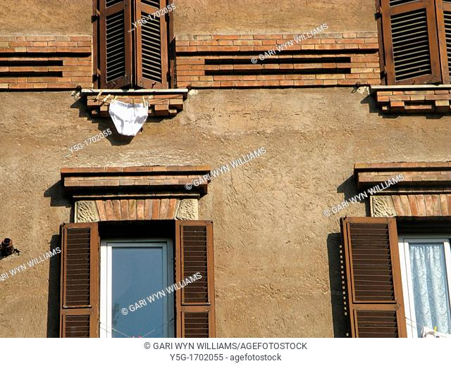 clothes on washing line in rome, italy