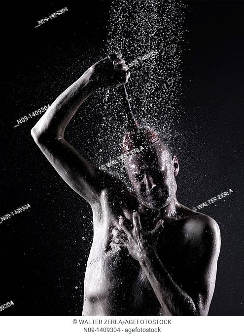 man takes a shower with plunger on his head