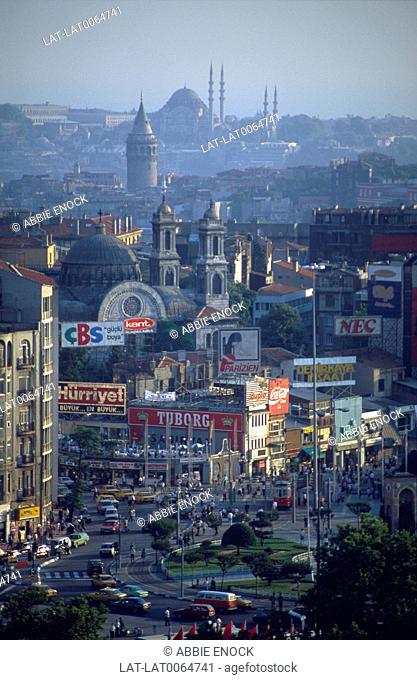 Istiklal Caddesi/ Kadesi. Taksim business district. Traffic on road. View of Galata tower/ mosques/ old city