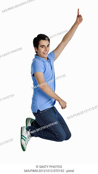 Happy man jumping and pointing