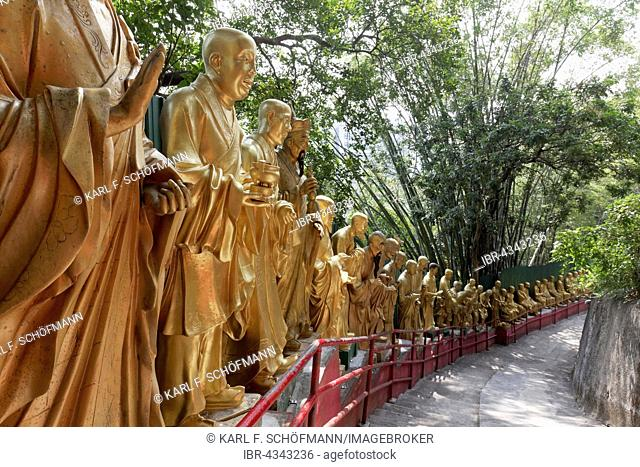Lifesize, gilded figures of Arhat, Buddhist Sage, on the way to the Monastery of 10,000 Buddhas, Sha Tin, New Territories, Hong Kong, China