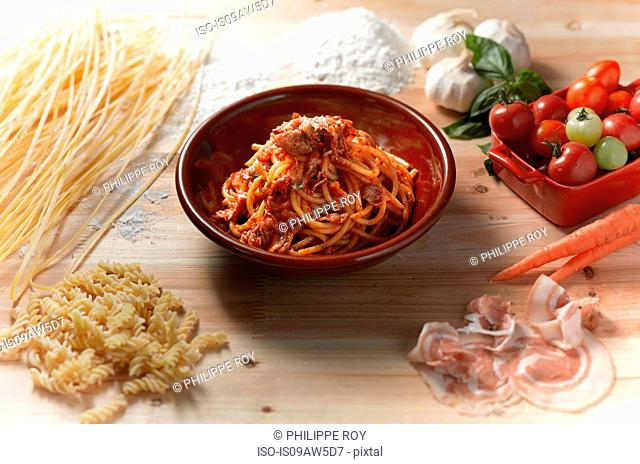 High angle view of spaghetti with parma ham sauce in bowl