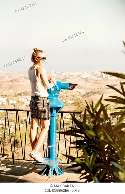 Woman by telescope on viewing platform, Mijas Pueblo, Andalucia, Spain